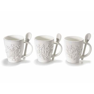 Set 3 tazze in ceramica bianca con decoro in rilievo e cucchiaino
